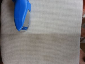 Cleaning in progress, badly stained upholstery